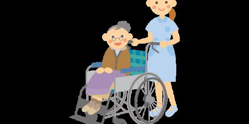 車いすに座る老人を介助する女性